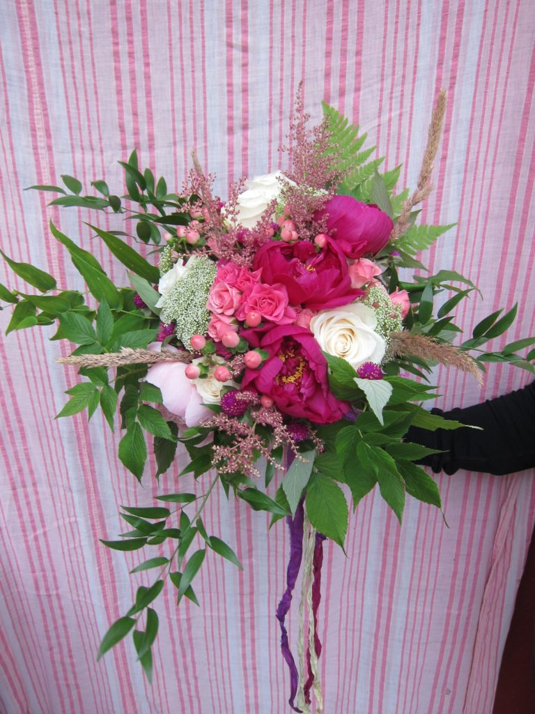 A bright and cheerful Alaska wedding | Bridal bouquet made with ivory roses, queen anne's lace, spray rose, Japanese aster, wild grass, astilbe, wild fern, wild raspberry and Italian ruscus. Designed by Natasha Price of Alaska Knit Nat