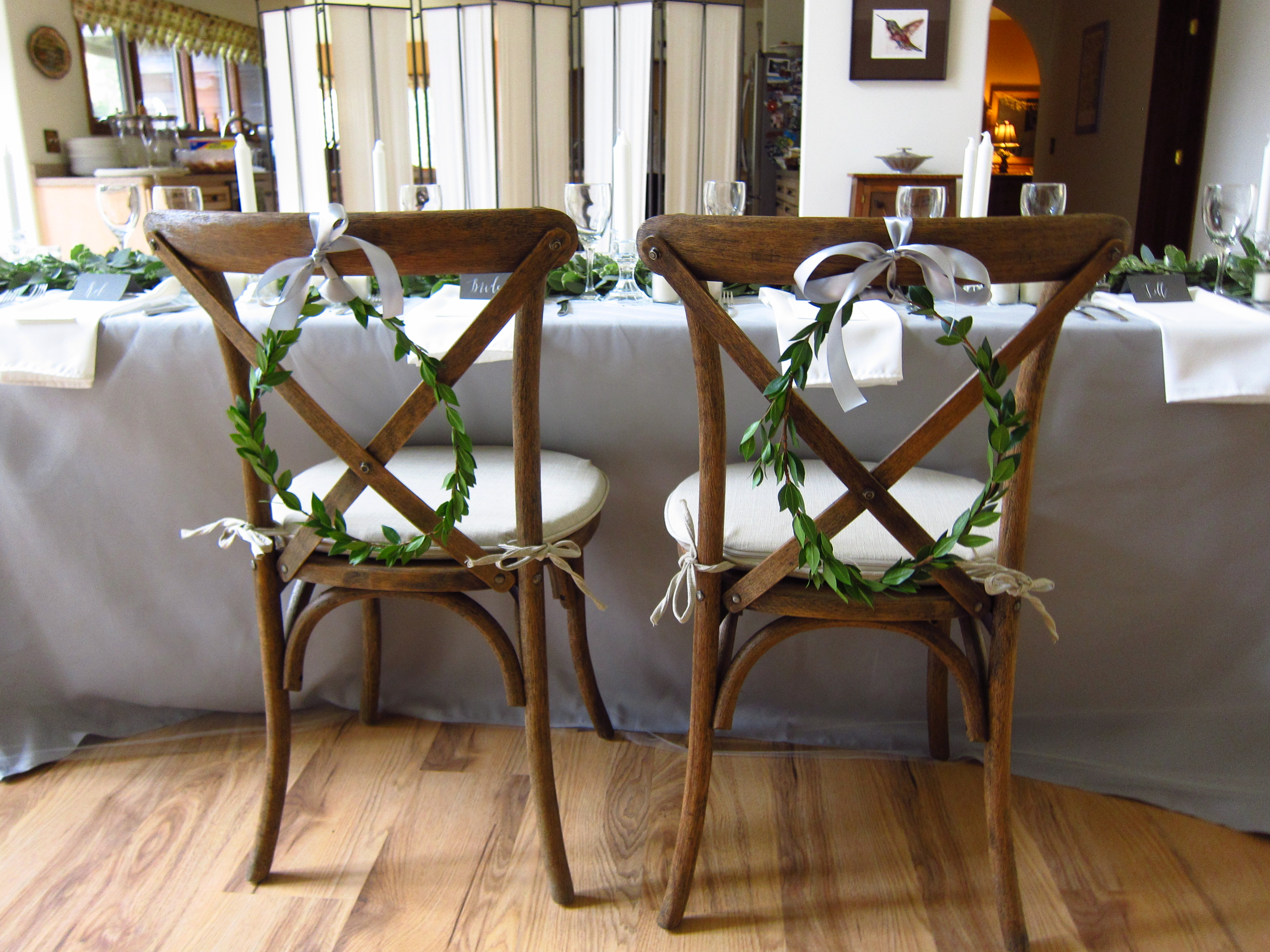 Delicate myrtle wreaths for bride and groom's chairs | designed by Natasha Price of Paper Peony