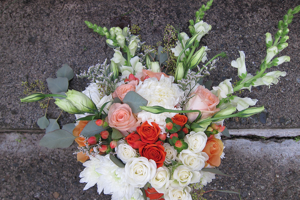 Orange, peach and cream bridal bouquet with snapdragons | designed by Natasha Price of Paper Peony Alaska