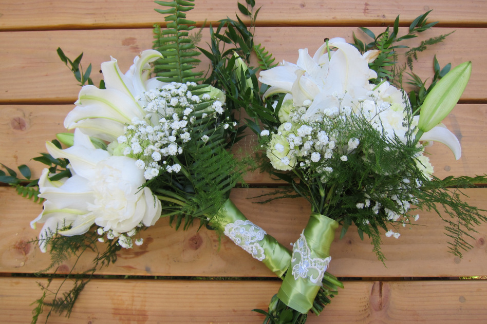 Bridal bouquets made with lilies, white peonies, baby's breath, plumosa fern, sword fern, green carnations and Italian ruscus | Wedding flowers designed by Natasha Price of alaskaknitnat.com