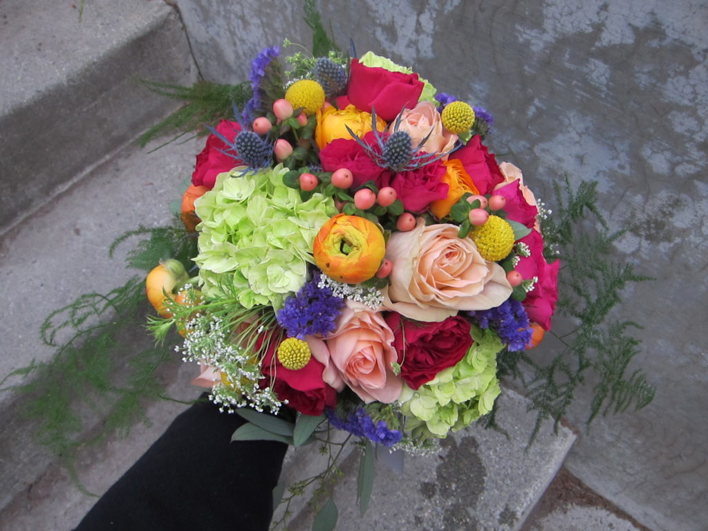 Rainbow bridal bouquet designed by Natasha Price of Paper Peony Alaska
