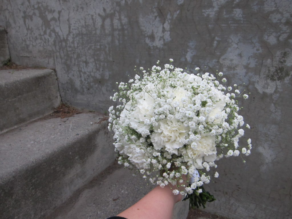 Classic bridal bouquet of white carnations and baby's breath   designed by Natasha Price of Paper Peony Alaska
