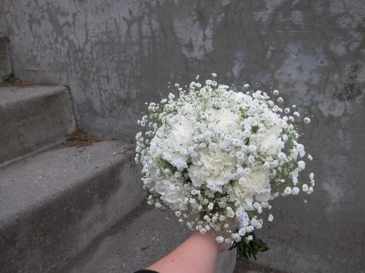 Classic bridal bouquet of white carnations and baby's breath | designed by Natasha Price of Paper Peony Alaska