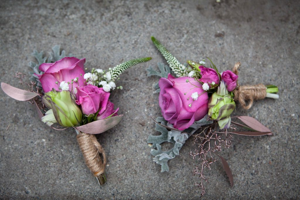 boutonnieres with purple roses, dusty miller and white veronica | designed by Natasha Price of Paper Peony Alaska