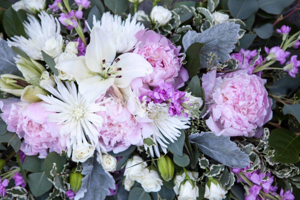 Wedding arch spray with peonies, fuji mums, lilies, stock, spray roses, pittosporum, salal and euclayptus | Designed by Natasha Price of Paper Peony Alaska