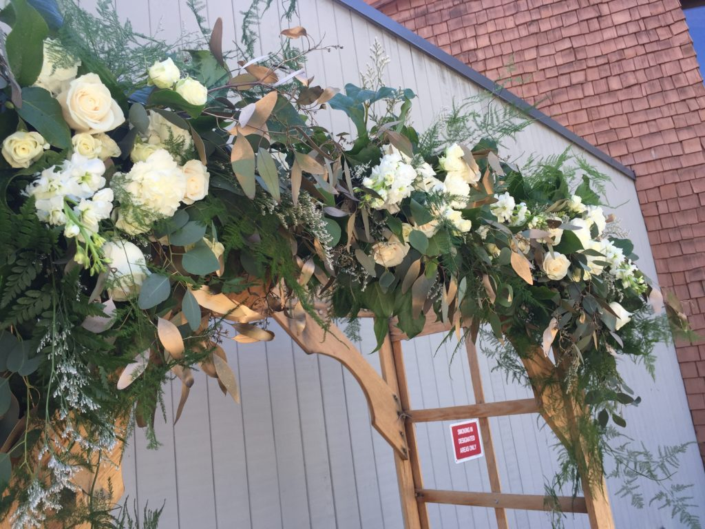 wedding arch with white roses, white carnations, white spray roses, fern, salal, eucalyptus and plumosa | designed by Natasha of Paper Peony and Kate of Simple Petal