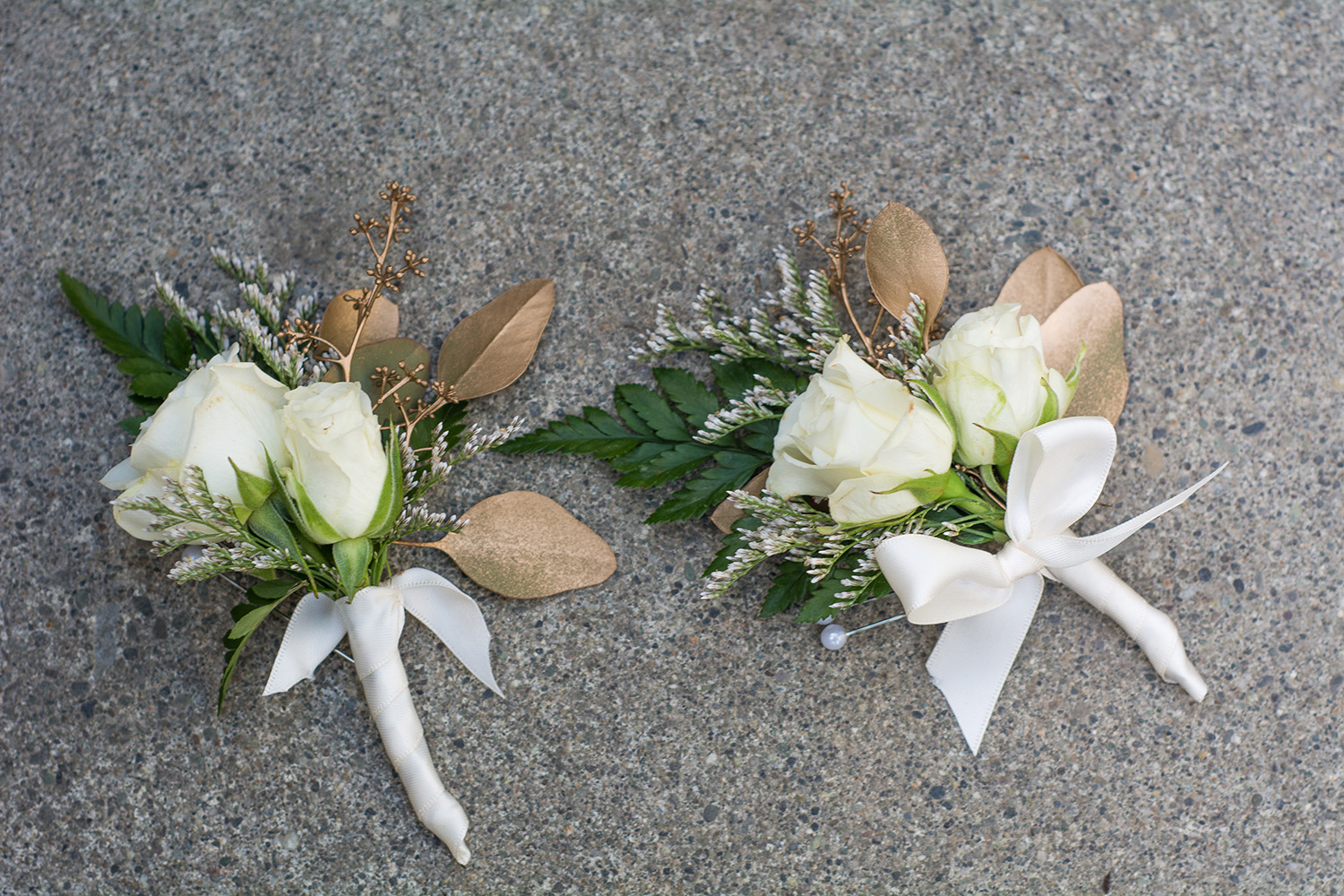White and gold boutonnieres designed by Natasha Price of Paper Peony Alaska | Photo by Sean Carpenter