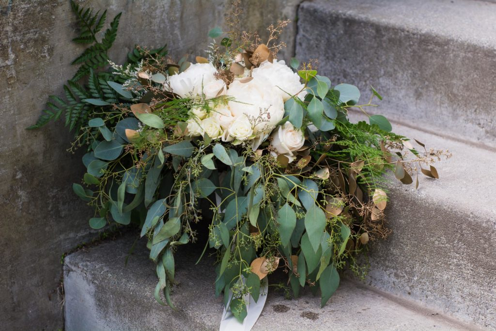 Bridal bouquet with white peonies and eucalyptus | designed by Natasha Price and photo by Sean Carpenter