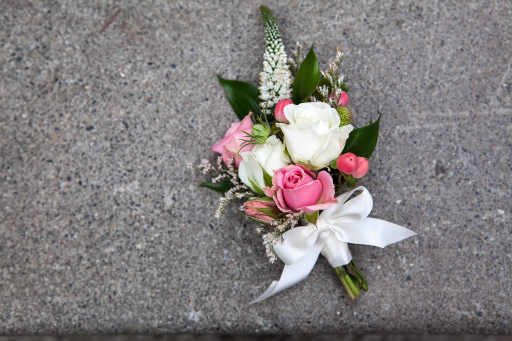 Cosage with pink and white spray roses, veronica and hypericum berry | designed by Natasha Price of Paper Peony Alaska