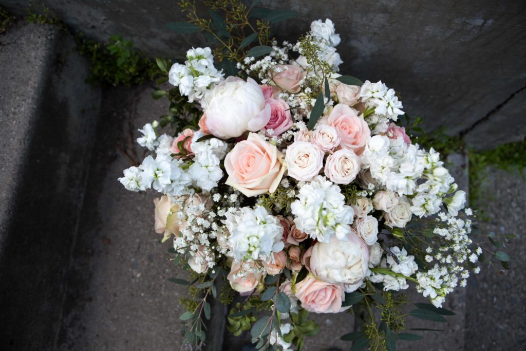 Fluffy white stock, blush roses, baby's breath and eucalyptus memorial bouquet by Paper Peony Alaska