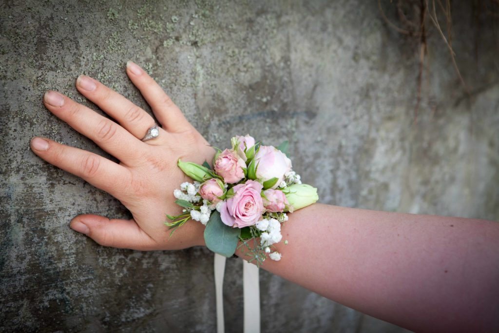 Floral bracelets resemble wrist corsages but are much more durable. Designed by Paper Peony Alaska