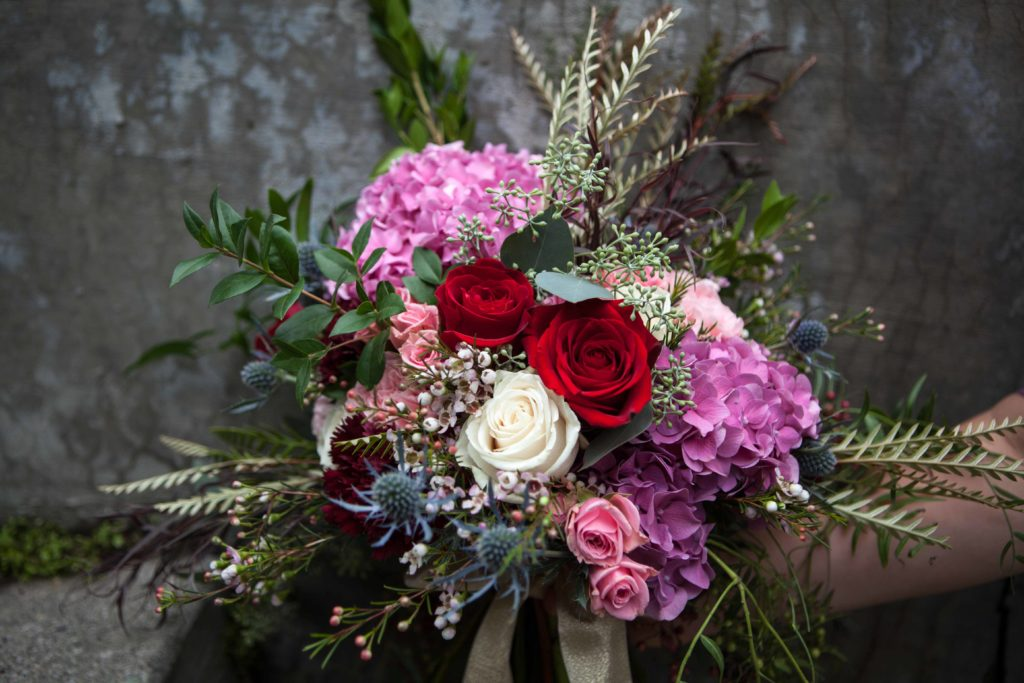 Colorful burgundy bridal bouquet by Paper Peony Alaska